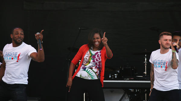First Lady Michelle Obama wears her signature cardigan while dancing with performers from the television show <em>So You Can Dance</em> during the annual White House Easter Egg Roll on April 6, 2015.
