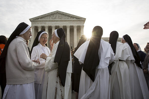 Nuns opposed to the Affordable Care Act's contraceptive mandate rally outside the Supreme Court on March 23 prior to oral arguments in <em>Zubik v. Burwell. </em>The Supreme Court sent the case back to a lower court on Monday.