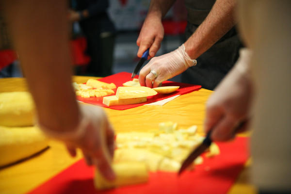 Chefs from José Andrés' ThinkFoodGroup chop squash that will go into a giant paella.