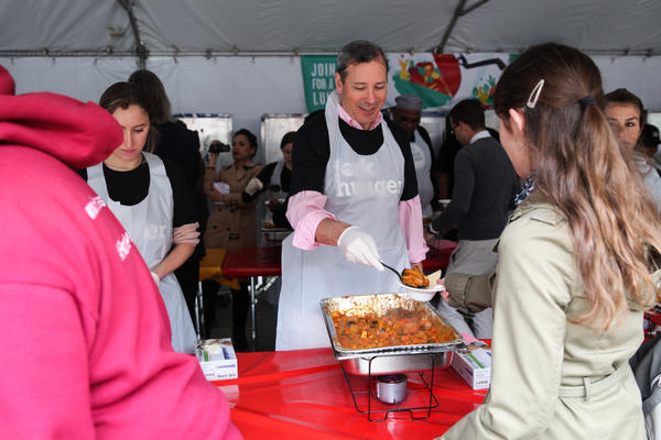 Volunteers serve curry at the Feeding the 5000 event.