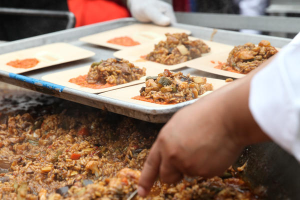 Volunteers prepare to hand out plates of paella made by celebrity chef José Andrés and his team.