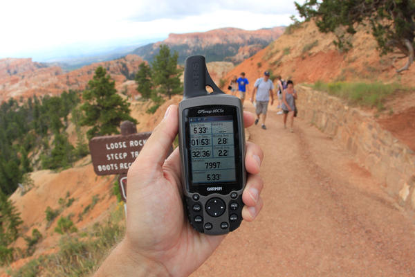 GPS and emergency beacons are becoming more popular on the trail.  But experienced hikers say people on long hikes should know how to read a map and use a compass in case the location technology they've brought along fails. (daveynin/Flickr)