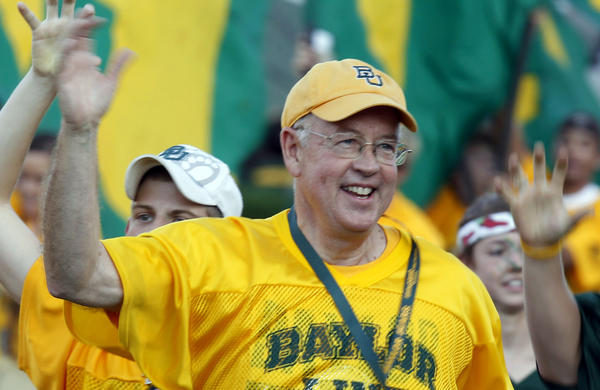 Baylor University President Kenneth Starr runs onto the football field before a 2011 game against Texas Christian University in Waco, Texas. Starr became president of Baylor in 2010.
