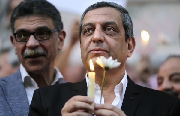 Yahia Kalash, the head of the journalists union, holds a candle during a vigil on May 24 for the recent victims of an EgyptAir crash. Kalash and two other board members of the journalists union are facing trial on allegations they published false news and harbored journalists wanted by authorities.