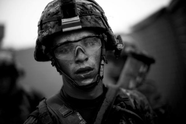 """Bravo Company's Pvt. Cody Lee Ensley walks through the safety of the gates at an American base after a daylong fierce attack by insurgents near Payendi. <em>From the story """"<a href=""""http://www.npr.org/2010/10/22/130756452/signs-of-traction-in-u-s-fight-against-afghan-taliban"""" target=""""_blank"""">Signs Of Traction In U.S. Fight Against Afghan Taliban</a>,"""" 2010. </em>"""
