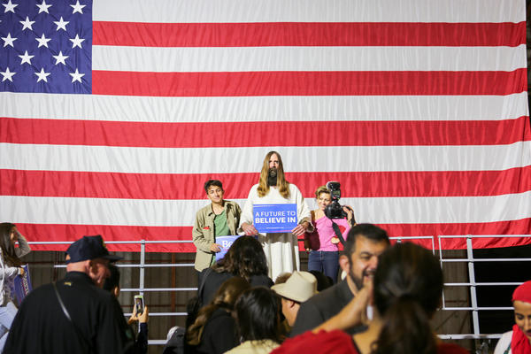 """""""Jesus,"""" a regular at Sanders rallies, poses with supporters after Sanders' loss in the California primary."""