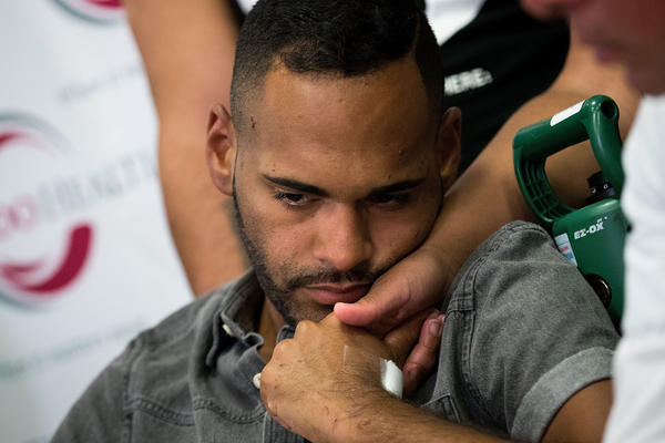 Angel Colon, who was injured in the Pulse nightclub shooting, is comforted by siblings during a press conference at the Orlando Regional Medical Center on Tuesday.