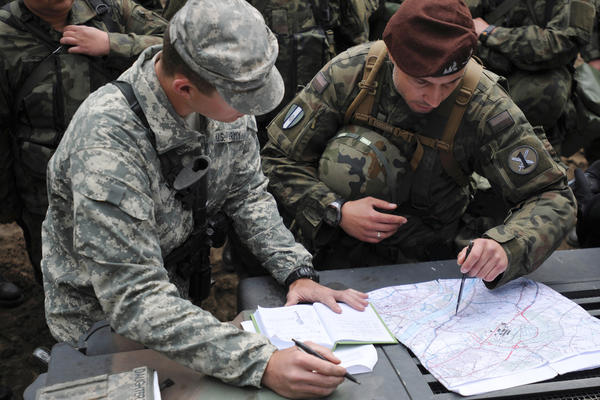 1st Lt. Nathan Meyer, assigned to the 175th Military Police Battalion with the Missouri National Guard, explains the designated route U.S. and Polish soldiers will use to practice route reconnaissance during the Anakonda 16 exercise near Chelmno, Poland.