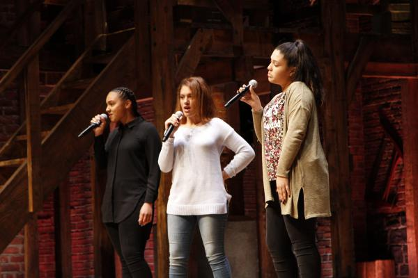 Onstage at the Richard Rodgers Theatre, students perform an original song inspired by Revolutionary Era history.