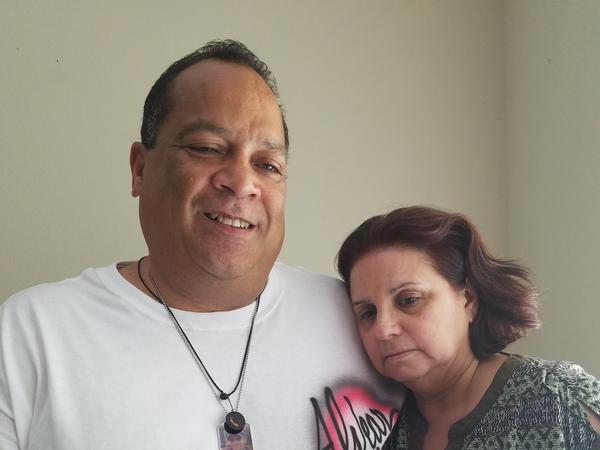 "Daniel Alvear and his wife, Mayra, in their home --€"" hours before the funeral for Flores."