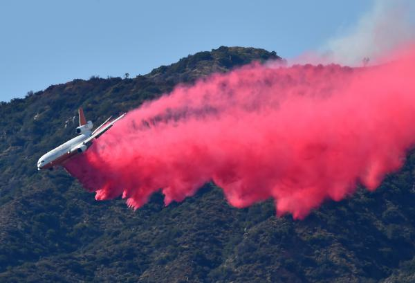A DC-10 air tanker drops fire retardant in Duarte, Calif., on Monday. Twin fires have already scorched more than 3,500 acres and continue to burn with zero percent containment in the San Gabriel Valley, northeast of Los Angeles.