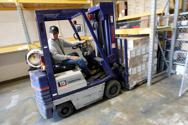 Bob Delaney moved a pallet of surgical masks in Utah in 2009. Like other states, Utah received supplies from the Strategic National Stockpile to prepare for a flu pandemic.
