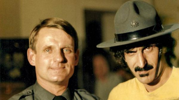 Zappa in 1981 with Pennsylvania state trooper Chuck Ash, who interviewed the musician during an anti-drug campaign run by the Montgomery County school district.