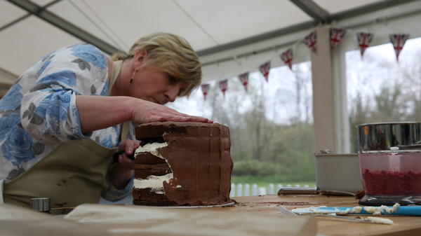 Sandy works on her cake in an episode of <em>The Great British Baking Show</em>, which begins its second season on Friday.