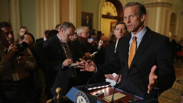 Sen. John Thune talks with reporters following the Republicans' weekly policy luncheon at the U.S. Capitol.