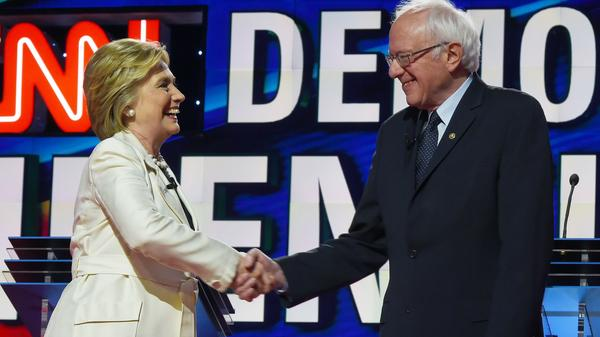 Hillary Clinton and Bernie Sanders shake hands before an April Democratic presidential debate in New York.