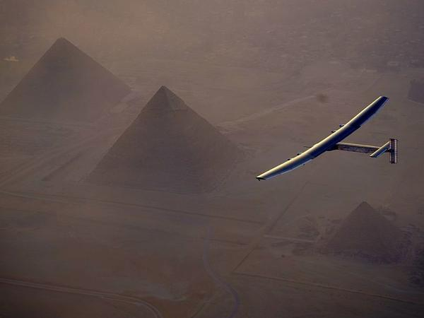 Solar Impulse 2, the solar powered plane, flies above Giza Pyramids as it finishes its penultimate flight, landing in Egypt on Wednesday.