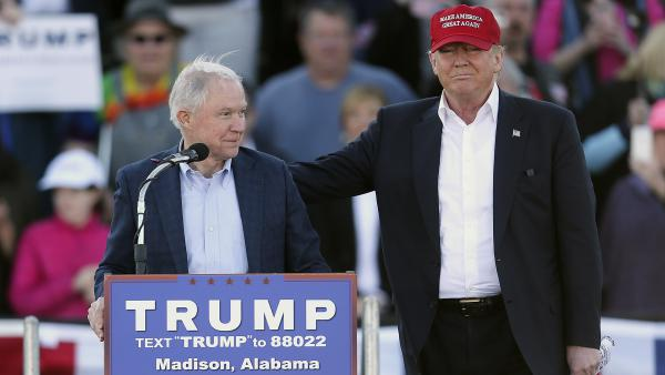Republican presidential candidate Donald Trump, right, stands next to Sen. Jeff Sessions during a rally in Madison, Ala. on Feb. 28.
