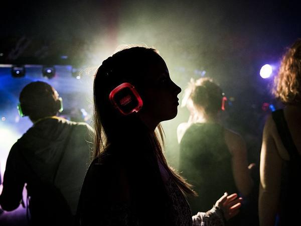 A woman wearing headphones dances in a disco during the Clockenflap Music Festival in Hong Kong, China last year.