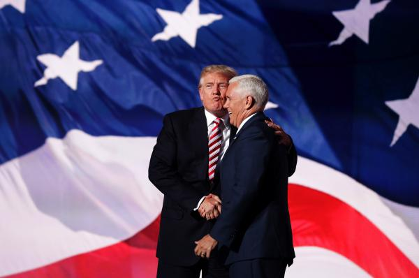 Trump congratulates his running mate, Pence, after his speech.