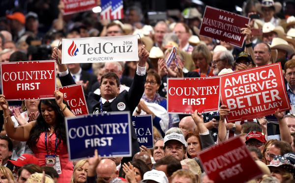 A delegate holds up a sign for Cruz in a sea of Trump supporters on Wednesday night.