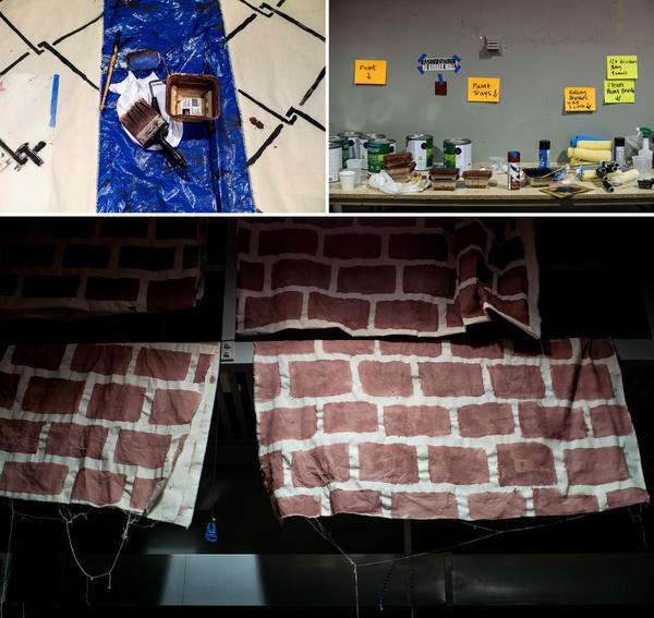 Paint supplies are laid out and completed panels are hung to dry as members from Mijente and other groups prepare for Wednesday's protest.
