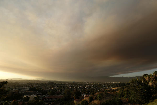 Smoke from a Los Angeles wildfire drifts over the city's downtown, about 30 miles from the fire's location in Santa Clarita.