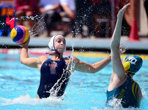 Maggie Steffens of the United States (left) launches out of the water as she shoots during the 2016 Olympic team trials in Los Angeles on May 22.