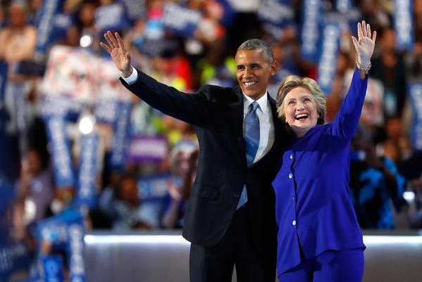 Hillary Clinton joins President Obama onstage after he delivers his speech at the Democratic National Convention on Wednesday.
