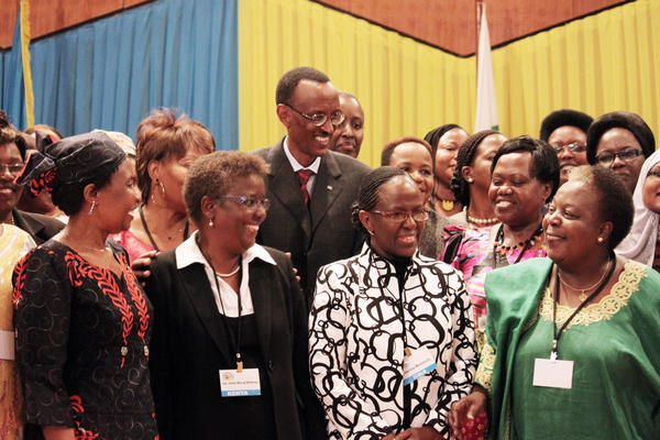 Rwandan President Paul Kagame (center) has been a proponent of putting women in positions of power. He's shown participating in a 2010 conference at the nation's Parliament to discuss the role of women.