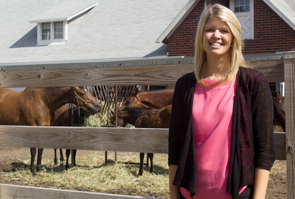 Haley Banwart, pictured at the Iowa State horse barn, grew up on her family's farm. She is working and getting a master's degree at Iowa State. Her brother plans to return home to farm after college.