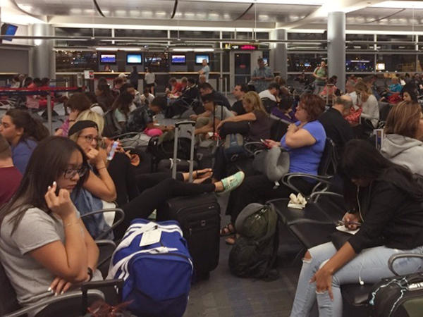 Passengers packed the boarding area at McCarran International Airport in Las Vegas following Monday's Delta outage.