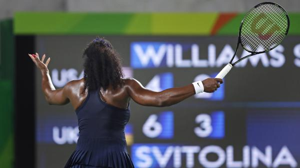Serena Williams of the United States throws up her arms as she faces the scoreboard while trailing Elina Svitolina of Ukraine in the second set. Williams, the top seed, lost 6-4, 6-3.