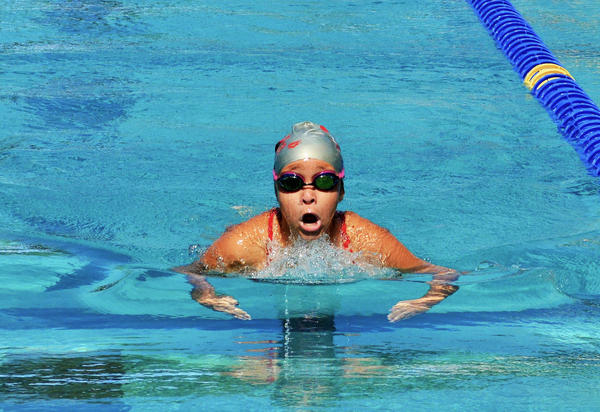 Emily Lopez-Diaz, 11, swims for the YMCA of South Florida Barracudas in the Miami area. Her father, Josue Lopez, estimates that about 30 percent of the team is Latino.