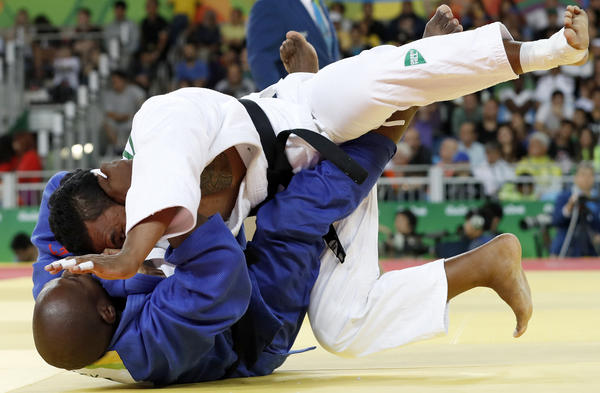 Nauru's Ovini Uera (white) competes with Belize's Renick James during their men's 90kg judo contest match in Rio on Wednesday. Uera won this match, but was eliminated in the next round.