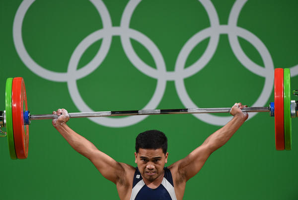 Nauru's Elson Brechtefeld competes during the men's 56kg weightlifting event on Aug. 7.