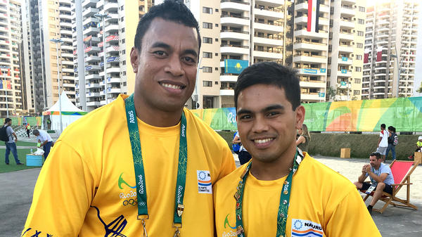 Ovini Uera (far left) and Elson Brechtefeld are the two sole delegates from Nauru.