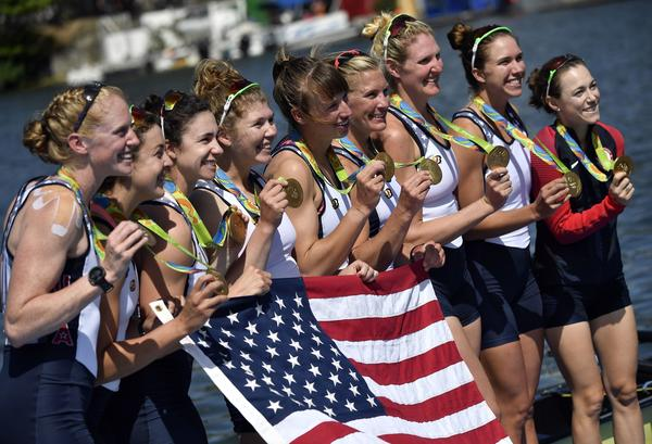 (Left to right) Emily Regan, Kerry Simmonds, Amanda Polk, Lauren Schmetterling, Tessa Gobbo, Meghan Musnicki, Eleanor Logan, Amanda Elmore and Katelin Snyder of the U.S. pose with their gold medals on the podium of the Women's Eight final rowing competition on Saturday.