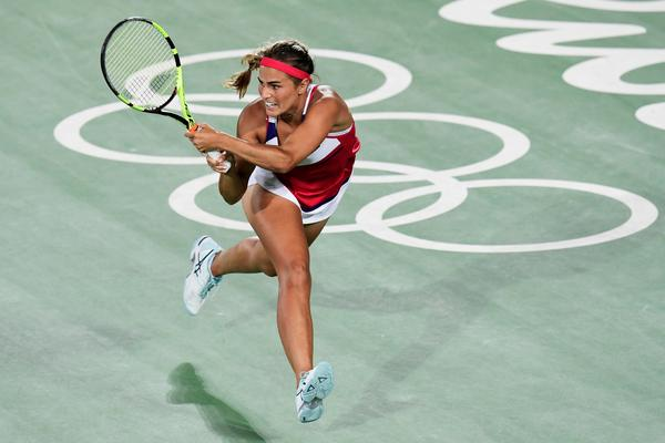 Monica Puig won Puerto Rico's first gold medal ever with a three-set victory over Germany's Angelique Kerber in women's singles on Saturday.