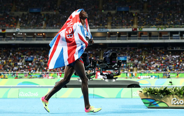 Mo Farah of Great Britain celebrates after winning the men's 10,000 meters on Saturday, defending his title from the 2012 London Games. Farah stumbled and fell during the race, but recovered to win with a blistering kick on the final straightaway.