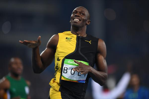 Usain Bolt of Jamaica wins the 100-meter final in 9.81 on Sunday, becoming the first man to ever win the race in three straight Olympics.