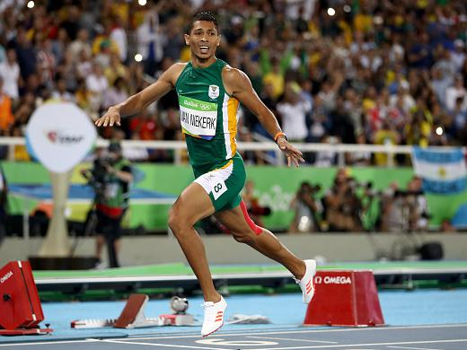 Wayde van Niekerk of South Africa celebrates after winning the 400-meter final and setting a world record of 43.03 on Sunday at the Olympic Stadium in Rio.