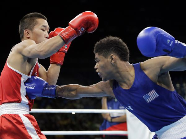 Shakur Stevenson of the U.S. fights Mongolia's Tsendbaatar Erdenebat in their bantamweight 56-kg quarterfinals match Tuesday in Rio de Janeiro. Stevenson won the bout by unanimous decision.