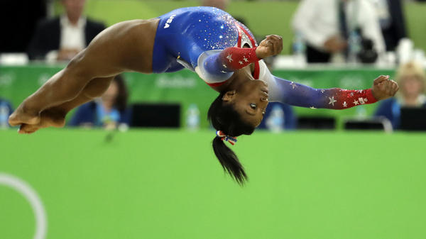 Biles performs on the floor exercise.