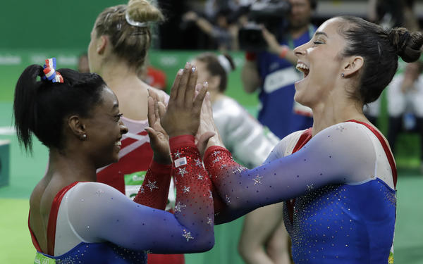 U.S. teammates, Simone Biles, who won the gold, and Aly Raisman, who won the silver, celebrate after final results for floor routine on Tuesday in Rio. It ws the fourth gold medal for Biles.