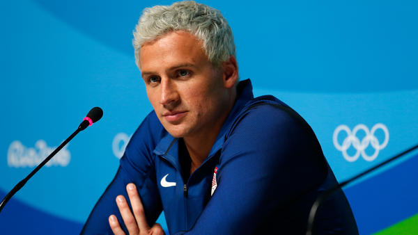 U.S. swimmer Ryan Lochte is back in the United States, his attorney tells NPR. Police in Rio want to speak to the swimmer about his story that he was robbed.