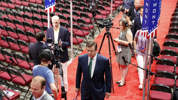 Trump campaign Chairman Paul Manafort walks off the floor of the Republican National Convention last month after talking to reporters.
