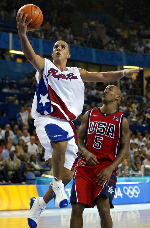 """Puerto Rico's shocking upset of the United States men's basketball team in the 2004 Olympics was layered with political subtext. """"It meant a lot — not only because of the sport, but because they did it to the U.S.,"""" said Antonio Sotomayor, a professor of Latin American and Caribbean studies."""