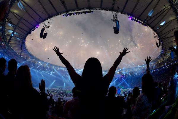 Spectators dance as fireworks light up the sky during the closing ceremony of the Rio 2016 Olympic Games on Sunday.