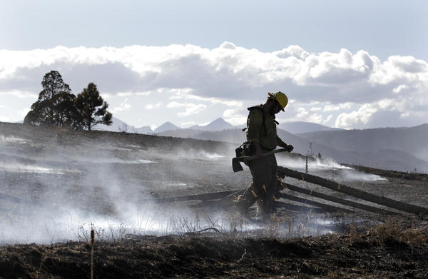 Firefighter David Yowell mops up hot spots in Sunshine Canyon, west of Boulder, Colo., on Sept. 10, 2010.